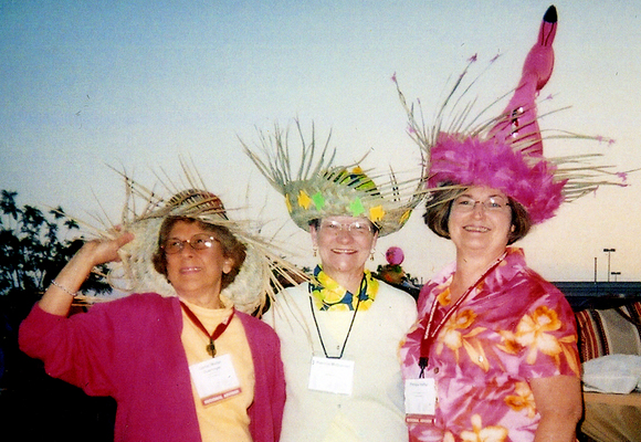 left to right: Carrel Muller, Patsy McDonnel, and Pat Hefler show off their hats at the 2005 SCBWI National Convention.