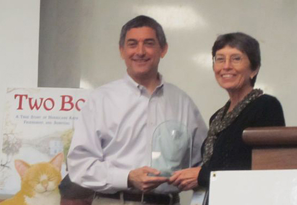 Jean Cassels receives an award from Jay Dardenne at the Louisiana Book Festival 2011 for illustrating Two Bobbies.